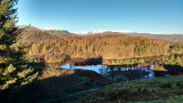 Looking west over Tarn Hows to the Langdale Pikes - a more rugged and wilder landscape