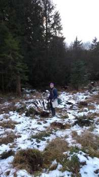 Martin planting trees in the snow