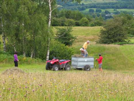 Bringing in the loose hay - Amelie watching by, Lynne leaning on a fork and Gary and Sarah stamping down the load
