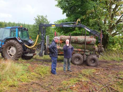 Gary and John by the much smaller forwarder John used to take timber from our wood