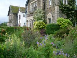 Yewfield is surrounded by colourful gardens and flower beds